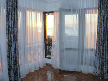 Interior with a view to the sea in the rays of the rising sun.  stock photography