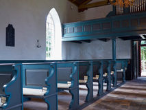 Interior view of a traditional church with empty pews Royalty Free Stock Photo