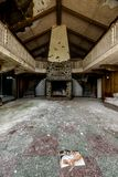 Mountain Lodge - Abandoned Nevele Resort - Catskill Mountains, New York. An interior view of a traditional mountain lodge with wood beams and paneling at the Stock Photos