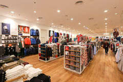 Interior view of Uniqlo store inside shopping mall. Stock Image