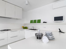 Interior view of a white modern kitchen Royalty Free Stock Images