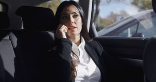 Interior view of woman on phone in limousine Stock Photos