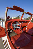 Interior of vintage car. A view of the bright red leather interior of a rare Excalibur cabrio or convertible, collector's car Stock Photo