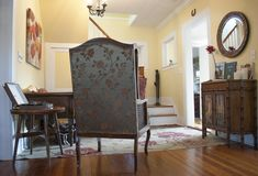 Interior with vintage furniture. Southern style. European retro pieces of furniture. Old armchair, old cabinet, vintage gramophone stock photo