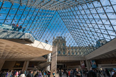 Interior and visitors at main entrance of Louvre museum. Royalty Free Stock Photo