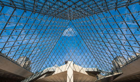 Interior and visitors at main entrance of Louvre museum. Stock Photography