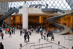 Interior and vistors of Louvre Royalty Free Stock Images