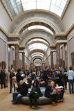 Interior and vistors of Louvre Stock Photography