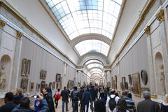 Interior and vistors of Louvre Royalty Free Stock Image