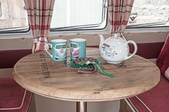 Interior of VW Camper van. VW camper van on show at Motor Mania showing table with teapot and mugs seen on 3rd September 2017 at Grantown on Spey stock photos