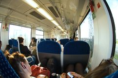 Interior wagon with passengers. Traveling in a train in Germany Royalty Free Stock Photo