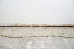 Wall Without Baseboard And Concrete Floor royalty free stock images