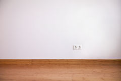 Interior wall with domestic power outlet Royalty Free Stock Photos