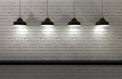 Interior wall illuminated by lamps above Stock Photos