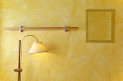 Interior wall mirrors, lamps and wooden shelves stock photography