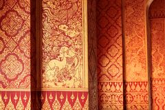 Interior wall painting of animal charactors. Thai interior exquisite golden mural Stock Photos