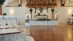 Interior of a wedding hall decoration ready for guests. Beautiful room for ceremonies and weddings. Wedding concept stock video