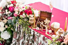 Interior of a wedding tent decoration ready for guests. Served round banquet table outdoor in marquee decorated flowers Royalty Free Stock Images