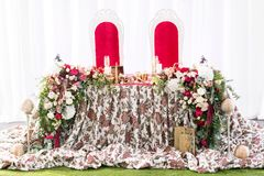 Interior of a wedding tent decoration ready for guests. Served round banquet table outdoor in marquee decorated flowers Royalty Free Stock Photo