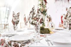 Interior of a wedding tent decoration ready for guests. Served round banquet table outdoor in marquee decorated flowers. And silk. Catering concept stock photo