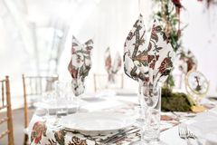 Interior of a wedding tent decoration ready for guests. Served round banquet table outdoor in marquee decorated flowers Stock Images
