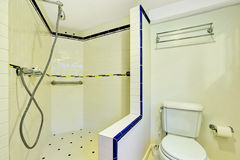 Interior of white bathroom with large walk-in shower royalty free stock image