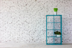 Interior in white brick with a bookshelf Stock Photography