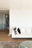 Interior, white divan. Interiors of a modern house, living room, white divan royalty free stock photo