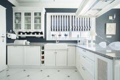 Interior of white and grey kitchen Stock Photos