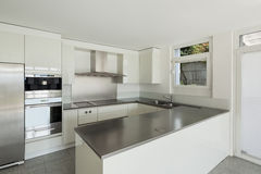 Interior, white kitchen. Architecture, interior of a modern house, white kitchen royalty free stock photography