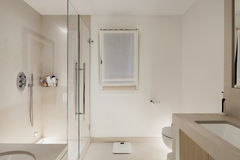 Interior, white modern bathroom. Glass box shower stock images