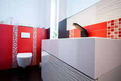 Interior of white and red bathroom Royalty Free Stock Image
