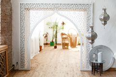 Interior of white room in arabian retro style. With beautiful white arch royalty free stock photos