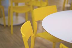 Interior of white table and yellow chair in food court shopping mall. Food center in department store. Interior of white table and yellow chair in food court stock photos