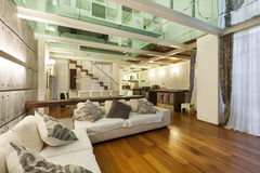Interior, wide loft. Architecture, wide loft with modern furniture, living room Royalty Free Stock Photo