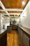 Interior, wide loft, domestic kitchen Stock Photography
