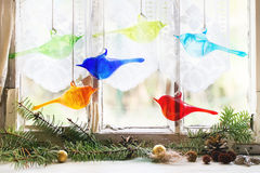 Interior window with glass birds and christmas Royalty Free Stock Images