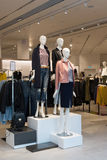 Interior of the womens clothing store with mannequins. Interior of the womens clothing store with a mannequins Stock Image