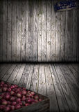 Interior Wood Barn, Grunge Background. Interior of a grunge wood barn, with apples in a crate and a vintage apple sign hiding in the dark corners. Two spotlight Royalty Free Stock Image