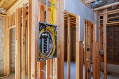 Interior wood framing of house under construction power supply for the house. Interior wood framing of house under construction electrician power supply for the stock photography