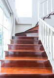 Interior wood stairs and handrail on background Stock Image