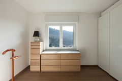 Interior, wooden cupboard under the window Stock Photo