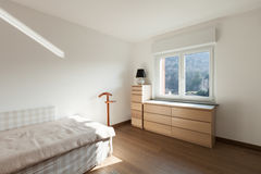 Interior, wooden cupboard under the window Stock Image