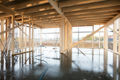 Wooden Incomplete Building With Wet Flooring. Interior of wooden incomplete building with wet flooring Stock Images