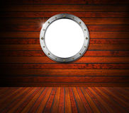 Interior Wooden Room with Metal Porthole Royalty Free Stock Photo