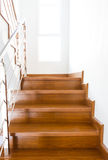 Interior wooden staircase of new house Stock Images