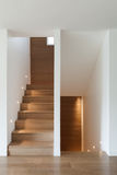Interior, wooden staircase and parquet floor Stock Photo