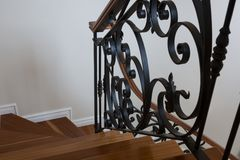 Interior wooden stairs with metal railing. At home Stock Photos