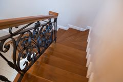 Interior wooden stairs with metal railing. At home Royalty Free Stock Images