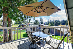 Interior of wraparound deck with amazing view of Lake Tapps. Royalty Free Stock Images